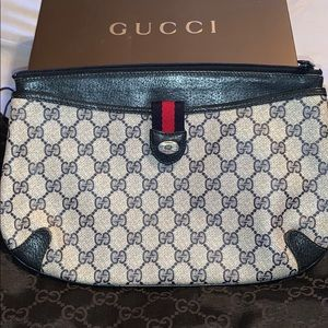Gucci supreme vintage clutch